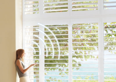woman-controlling-shutters-with-powerview_0